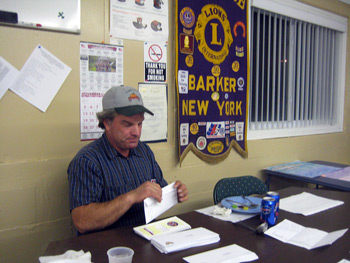 Photo:President Carl Stoloski stuffs envelopes at the recent Blind Seals Meeting