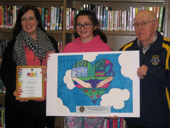 Natalie Brandel holding her winning entry in the Barker Lions Peace Poster Contest